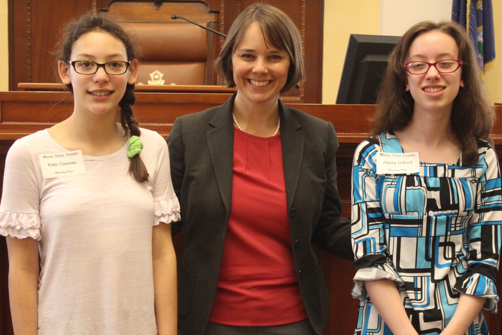 Hall-Dale Middle School students Kate Claveau, left, and Abbey Gifford, right, served as an honorary pages April 27 in the Maine Senate in Augusta. They were guests of Sen. Shenna Bellows, D-Manchester.