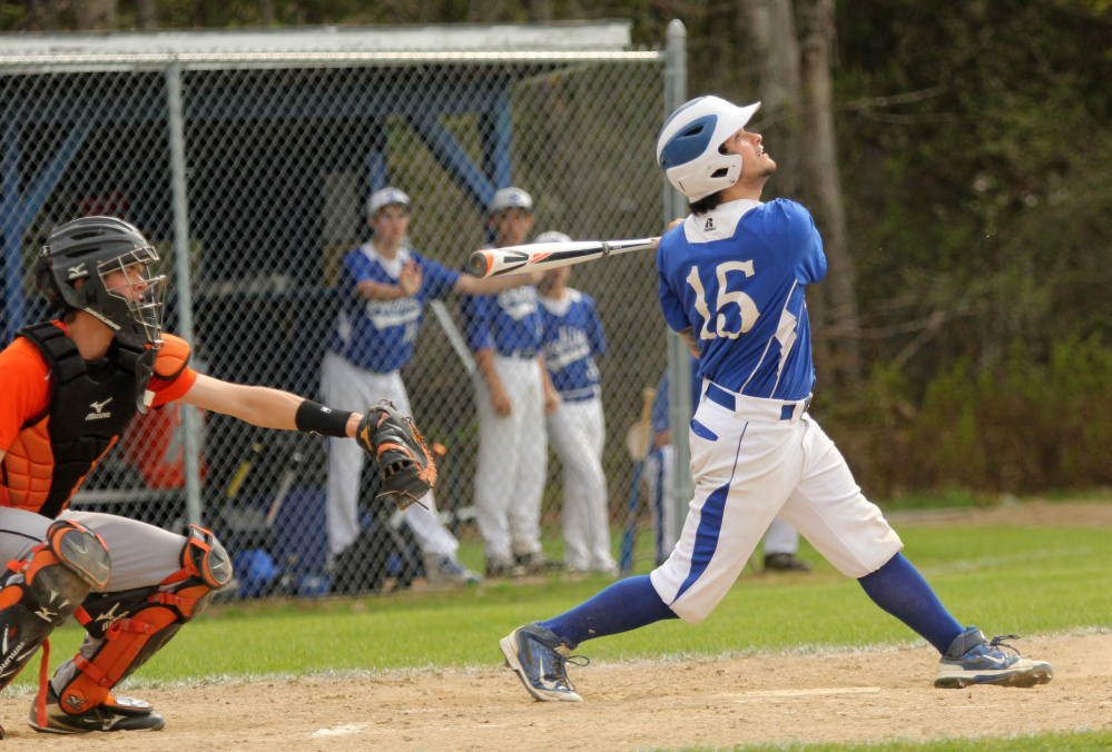 Photo by Jeff Pouland   Erskine Academy's Nick Turcotte pops up a pitch from Gardiner Area High School's Sam Jermyn on Saturday in South China.