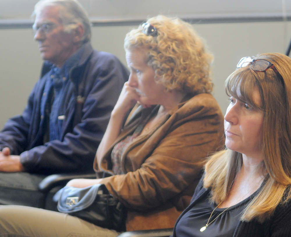"""Friends and relatives of three people killed in a 1996 car crash listen to testimony on Sept. 26, 2016, by Bryan Carrier at the Bureau of Motor Vehicles in Augusta where Carrier asked to have his driver's license restored. Carrier was convicted of manslaughter in the accident and his driving privileges revoked for life. From left are Royce """"Butch"""" Jewell, who lost his wife, Arlyce, and 10-year-old son, Alex, in the crash; Jewell's partner, Tanya Morris, of Canaan; and Tracey Rotondi, of Athens, the daughter of Jewell and Arlyce and sister of Alex."""
