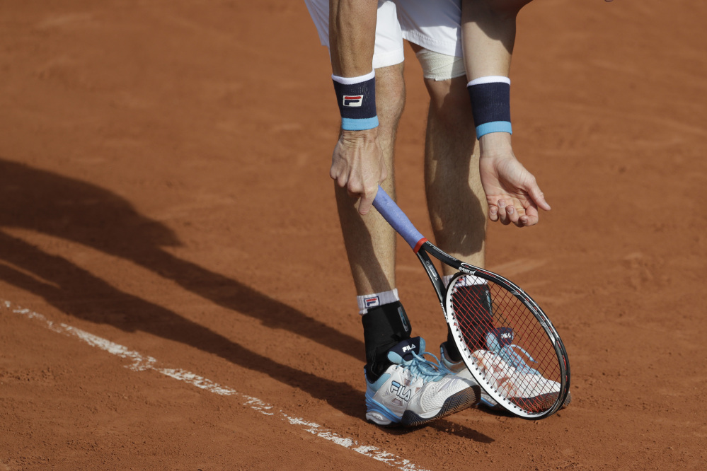 John Isner gestures after missing a shot against Australia's Jordan Thompson in their first round match of the French Open on Tuesday.