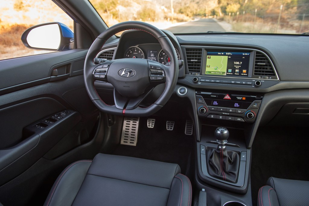 The 2017 Hyundai Elantra Sport flat-bottomed sport steering wheel feels good in the hands, though the steering doesn't pick up everything from the road.