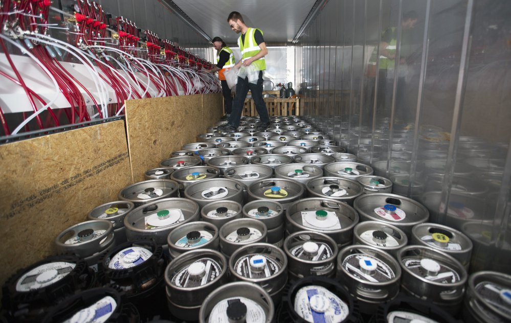 Davey Blackmon, left, and Jared Maruhnic, of Marshall Wharf Brewing Co., encase keg couplers in bubble wrap within the Maine Beer Box prior to being shipped to Iceland for a beer festival in June 2017. The custom-fabricated container boasts more than 70 kegs.
