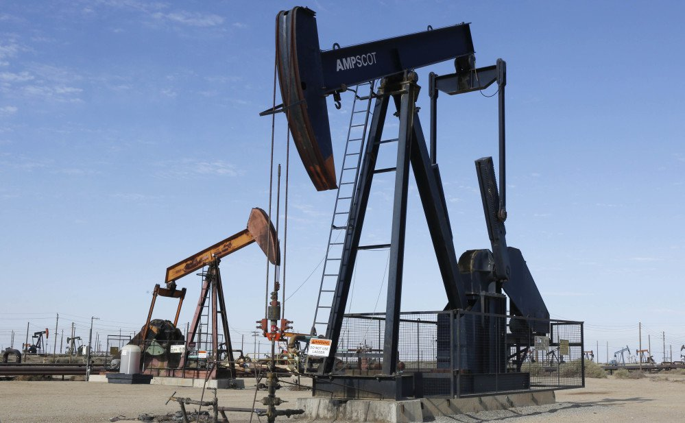 An oil field pump jack operates near Lost Hills, Calif. While Russia, Saudi Arabia and others have met targeted cuts, an unforeseen increase in U.S. supply has countered their efforts. Thus, consumers can expect cheaper energy and car fuel.