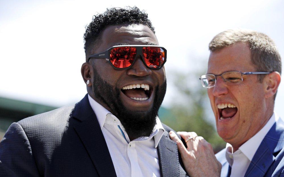 Retired Boston Red Sox designated hitter David Ortiz, left, shares a laugh with team president Sam Kennedy during a gathering where part of Yawkey Way was renamed David Ortiz Drive on Thursday outside Fenway Park in Boston. Ortiz's No. 34 will be retired in a ceremony prior to Friday night's game.
