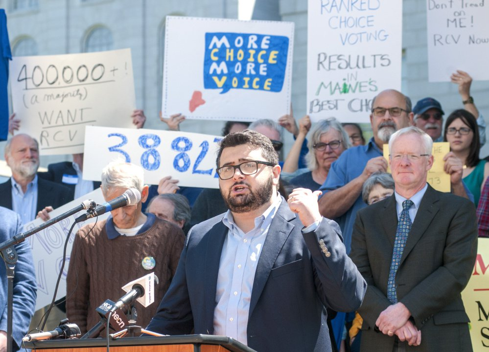 Adam Pontius, coalition coordinator for the Yes on 5 campaign, speaks at a rally to defend ranked-choice voting June 1 in Augusta.