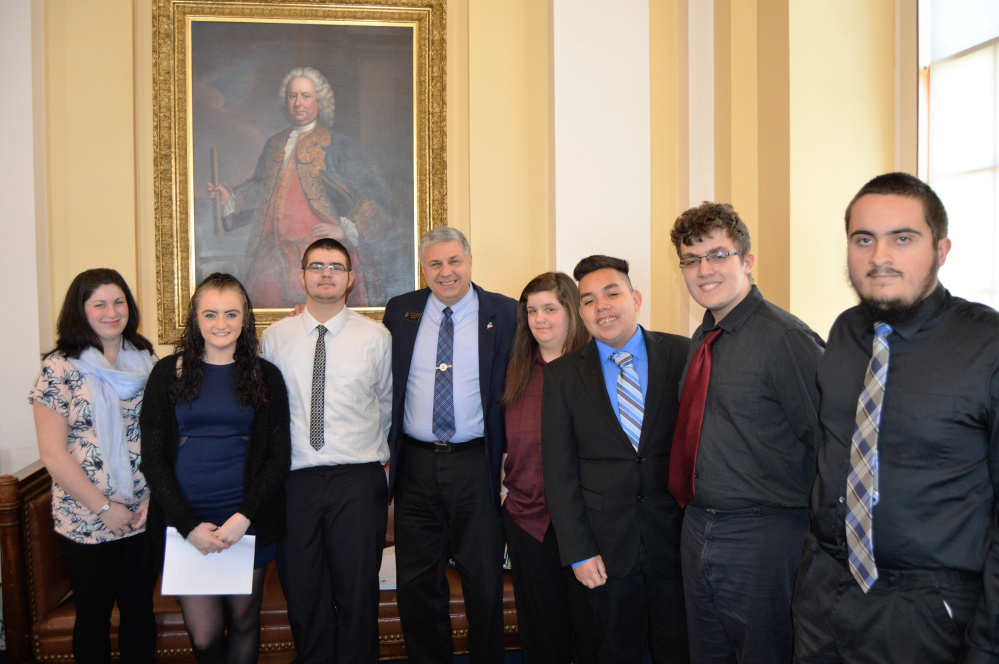 Students from the Jobs for Maine's Graduates program at Lawrence High School in Fairfield visited the State House in Augusta on May 16. From left are Katherine Wood, Keristin Grant, Hunter Loder, Sen. Scott Cyrway, Keisha Peace, Fernando Cuares, Seldon Thompson and Nicholas Richardson.
