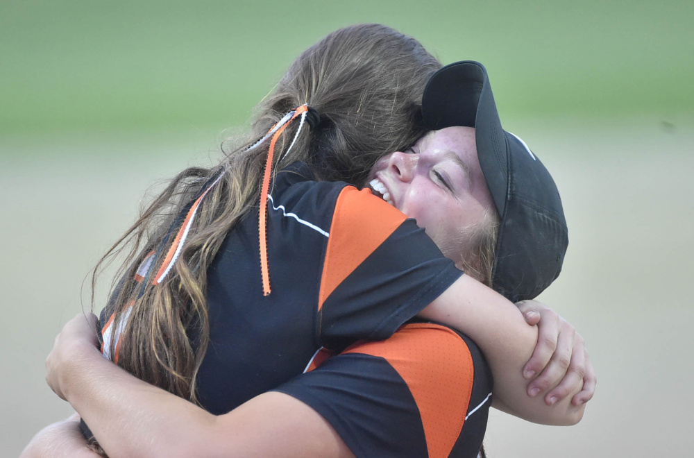 Skowhegan pitcher Ashley Alward embraces Julia Steeves after the Indians won the Class A North championship game Wednesday night in Augusta.