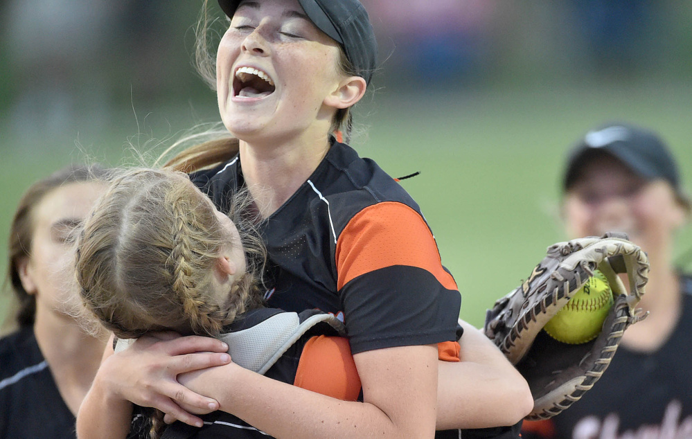 Skowhegan pitcher Ashley Alward jumps into the arms of catcher Sydney Reed after the Indians defeated Oxford Hills 5-4 in the Class A North championship game at Cony High School on Wednesday.