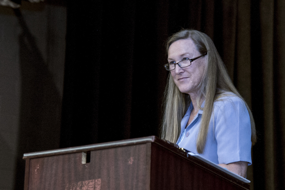 Mary Dennison moderates Farmingdale's Town Meeting on Saturday. The vent was held at Hall-Dale High School in Farmingdale.