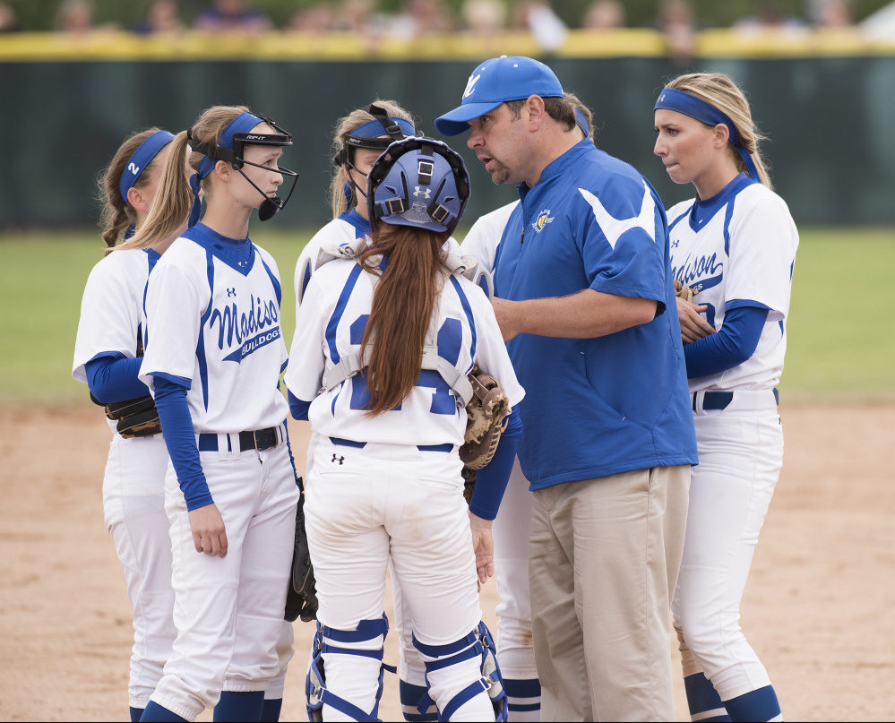 Kevin Bennett photo   Madison head coach Chris LeBlanc has a talk with his team during the sixth inning as they trail Bucksport 2-1 in the Class C state championship game Saturday in Brewer.