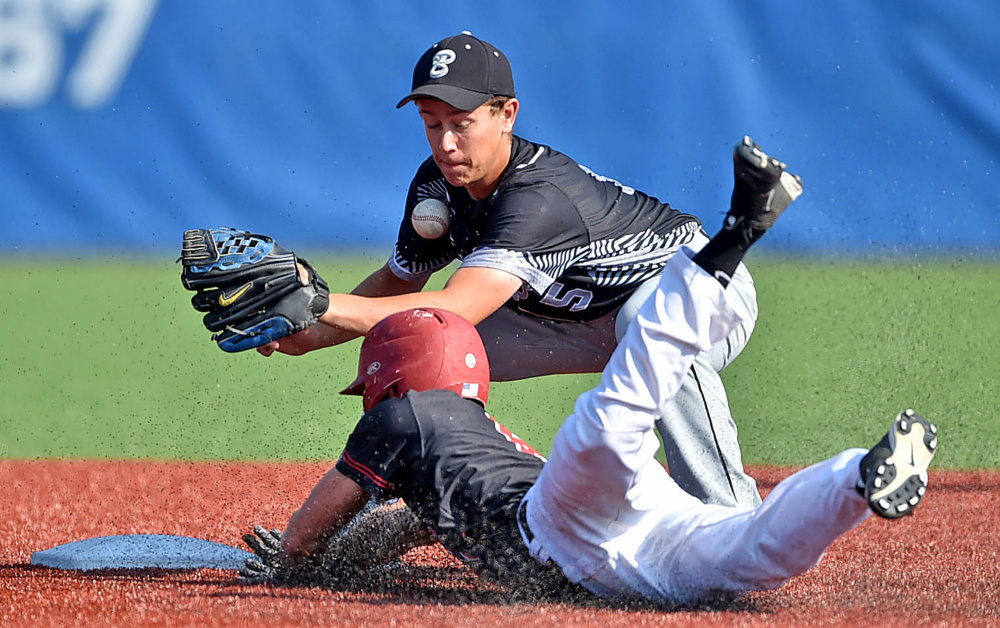 South All-Star second baseman Jordan Haley of Bridgeway, can't handle the throw as North All-Star Nick Botting from Houlton safely steals second base during the Class C/D All-Star game Friday at Colby College in Waterville.
