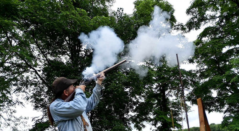 Terry Briggs, a member of the Ancient Ones, fires his musket Saturday during a historical demonstration at the annual Fort Halifax Days at Fort Halifax Park in Winslow.