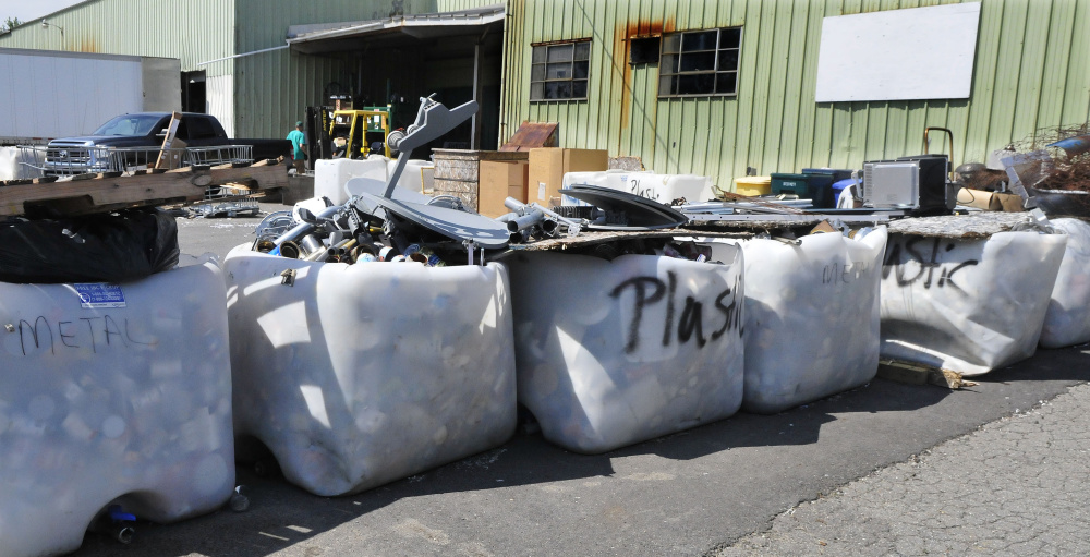 Residents take recycling items and deposit them in appropriate containers Thursday at the Waterville Recycling Center on the Armory Road in Waterville.