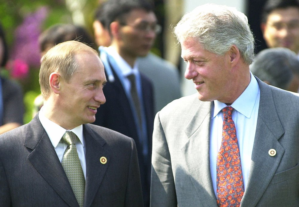 President Bill Clinton and President Vladimir Putin chat before a G8 meeting in Japan on  July 21, 2000.
