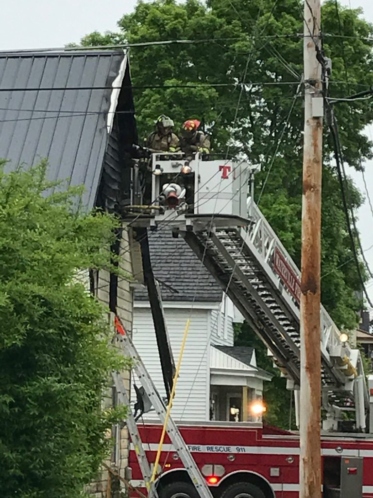 Waterville fire department extinguishes morning fire at a two-family home at 25 Spruce St. Thursday.