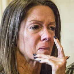 Susan Johnson wipes a tear from her cheek as James Pak receives two life sentences in the 2012 murders of her son, Derrick Thompson, and his girlfriend, Alivia Welch, in Superior Court in Alfred on Feb. 11, 2016. Johnson, who was wounded in the attack, is suing the city of Biddeford, claiming police didn't do enough to prevent the shooting.