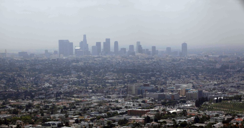 Smog covers downtown Los Angeles in 2009. Attorneys general from 15 states and the District of Columbia are suing over the Trump administration's delay of Obama-era rules reducing emissions of smog-causing air pollutants.