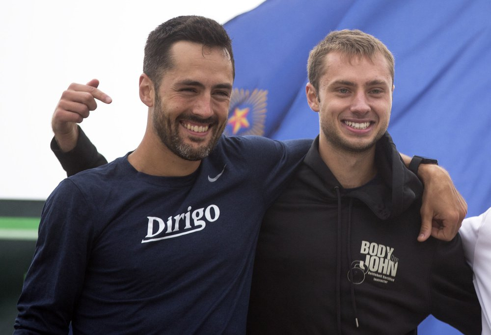 """Jesse Orach, right, who finished first in the Beach to Beacon among Maine men with an assist from Rob Gomez, left: """"I'm speechless with what he did."""""""