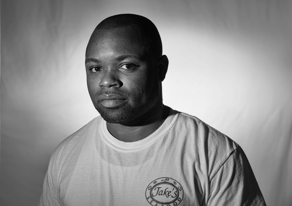 """Leanord Thompson of Jamaica cooks at Jake's Seafood restaurant in Wells as a temporary seasonal worker. He also works in Arizona and misses his family and friends. """"But it's working. You are not doing this for yourself anymore,"""" he said."""