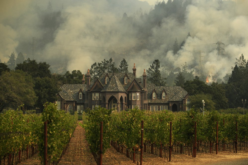 A wildfire burns behind a winery in Santa Rosa, Calif. Viral stories claiming a homeless man from Mexico was arrested on suspicion of arson for starting the wildfires that have left dozens dead are false. The Sonoma County sheriff's office tells the AP that the man was arrested, but the fire was a small one in a park that was quickly put out and there's no indication the fire is linked to the wildfire blazes.