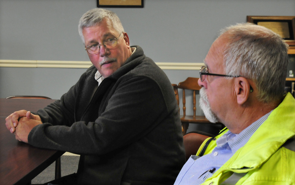 Winslow Town Manager Michael Heavener, left, and Winslow Public Works Director Paul Fongemie may have to look at curbside pickup, a penalty system or other ideas to increase recycling in Winslow after noting Monday that trash tonnage has changed little since a pilot recycling program was started in June.