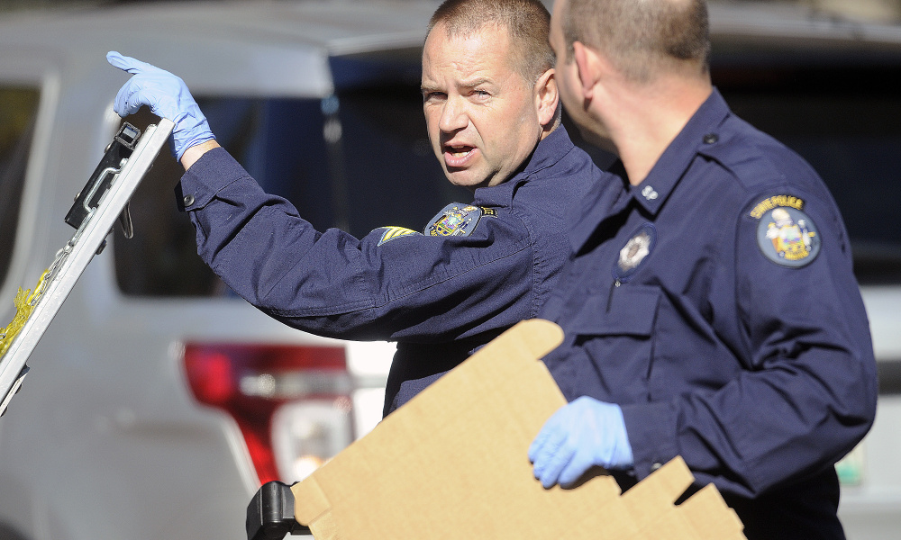 State Police Detective Sgt. Scott Bryant, left, confers November 1, 2016 with Detective Larry Rose while collecting evidence at the Balcer residence in Winthrop following the double murder.