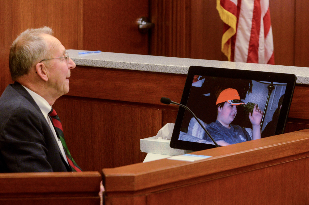 Andrew Balcer's grandfather Arthur Pierce, 82, looks at photo of Balcer during a hearing Thursday in Augusta to determine whether Balcer should be tried as an adult for allegedly killing his parents.