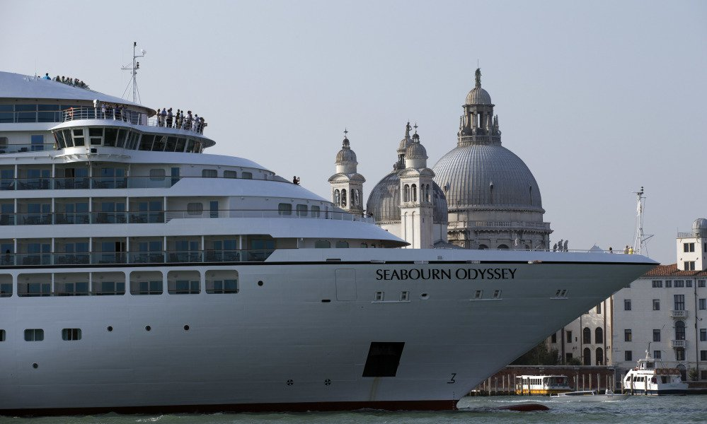 A cruise ship transits the Giudecca canal in front of St. Mark's Square in Venice, Italy, in this 2014 photo.