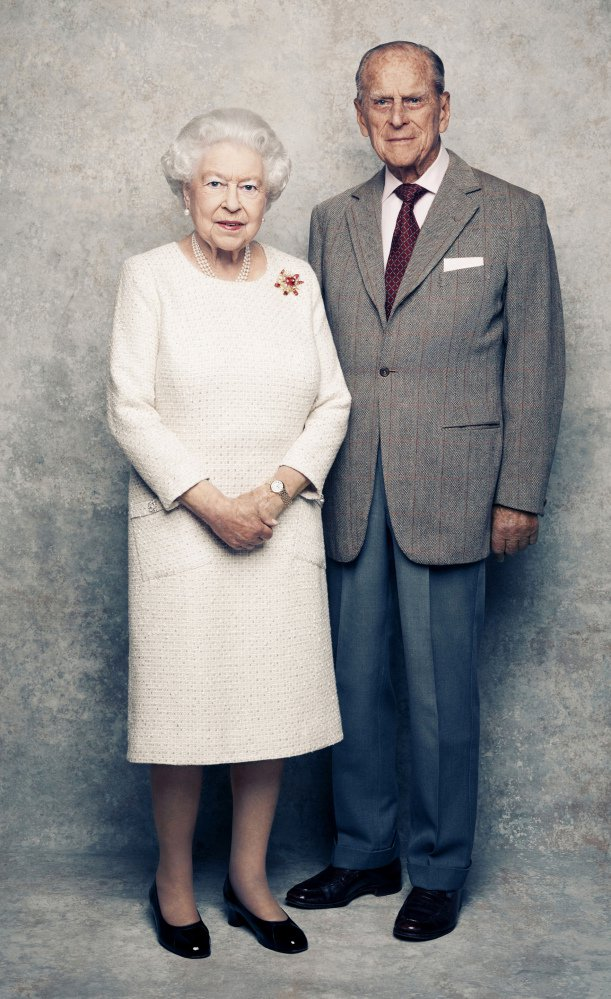 Queen Elizabeth and Prince Philip, shown against a platinum-textured backdrop at Windsor Castle in England, were married in 1947.