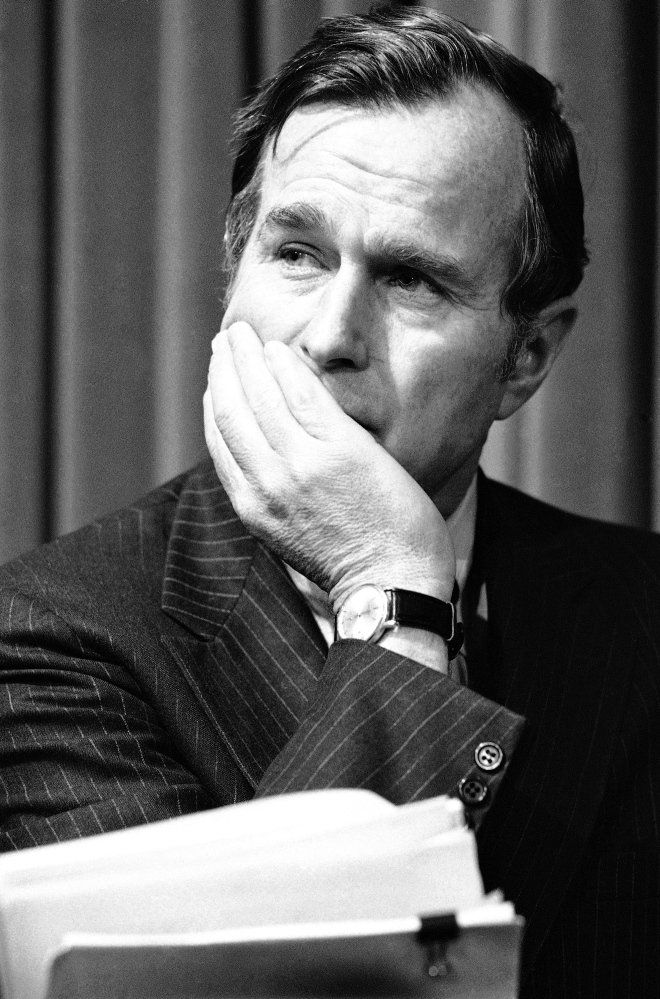 """Former President George H.W. Bush is pictured in December 1975, long before his election to the White House. """"This is hardly a sexual predator,"""" says Mark Updegrove, author of a newly released book titled """"The Last Republicans,"""" about the relationship between Bush and his son George W. Bush. """"This is a man who made an inappropriate gesture and a bad joke with women he didn't know well."""""""