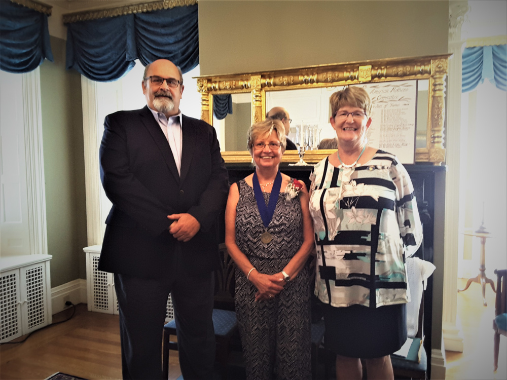 The 2017 Mother of the Year Kitty White, center, recently was honored at a silver tea reception at the Blaine House in Augusta. She was presented with proclamations from Rep. Donna Doore, D-Augusta, right, and Augusta's Mayor David Rollins.