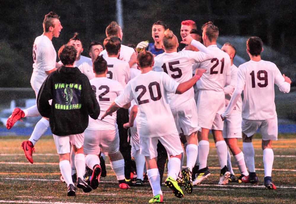 After time expires, the Richmond boys soccer team celebrates after winning the Class D South championship Thursday at McMann Field in Bath.