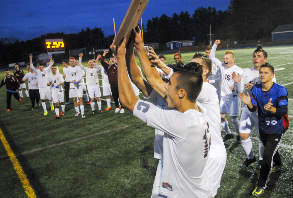 Richmond celebrates after defeating Buckfield in the Class D South championship Thursday at McMann Field in Bath.
