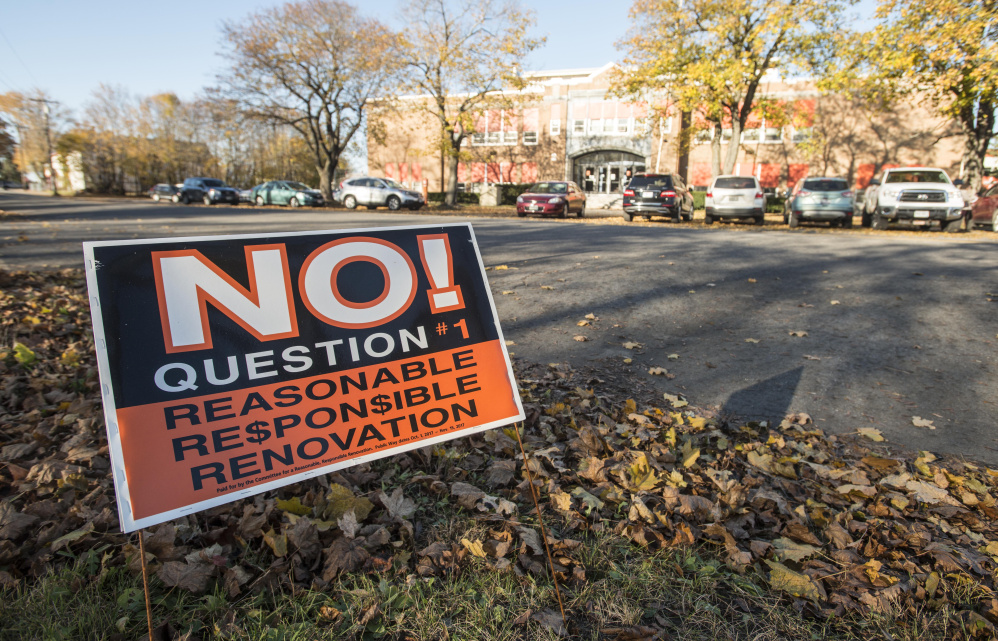A political sign urging voters to vote no on question 1 stands across the street from Winslow Junior High School Nov. 8 in Winslow.