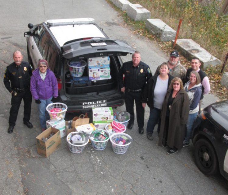 Skowhegan police Chief David Bucknam, center, with Sgt. Joel Cummings, left, and other volunteers collected needed items for the Somerset County domestic violence shelter during October, which waas domestic violence awareness month.
