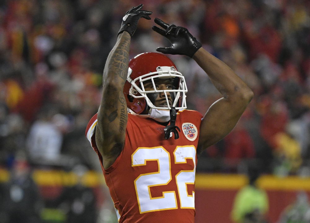 Kansas City defensive back Marcus Peters celebrates after intercepting a pass by Los Angeles quarterback Philip Rivers during the second half Saturday night in Kansas City, Mo. The Chiefs won, 30-13.
