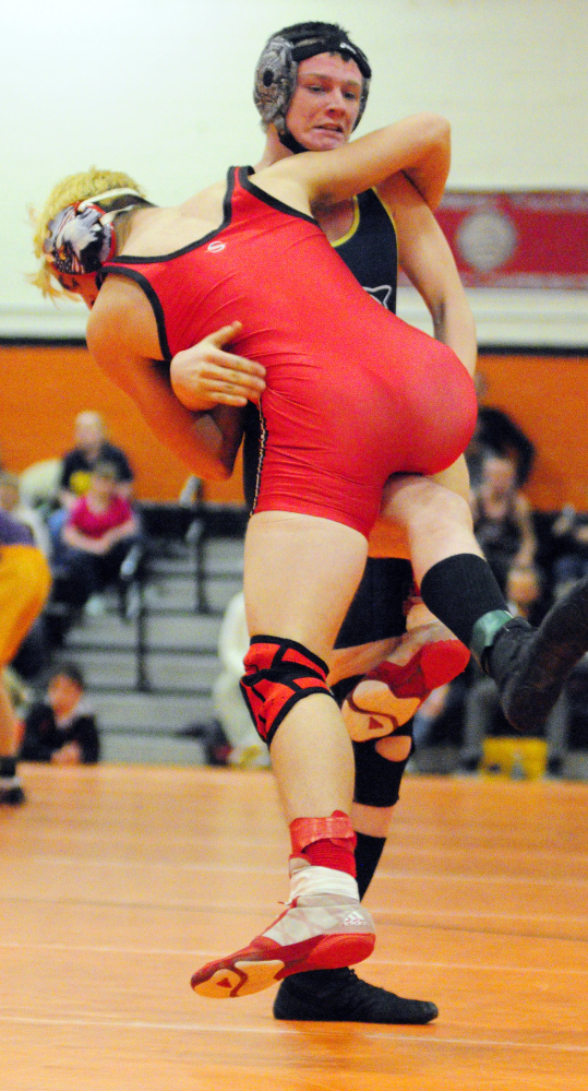 Cony's Jakob Arbour, left, and Mt. Blue's Hayden Nile compete in a 152- pound semifinal match during the annual Tiger Invitational lst Saturday in the James A. Bragoli Memorial Gym at Gardiner Area High School. Nile won the match. The wrestlers will compete in the annual Cony Duals this weekend.