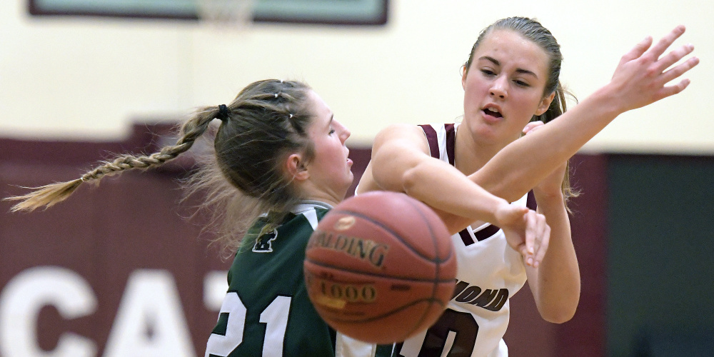 Richmond's Marybeth Sloat, right, passes around Winthrop's Kate Perkins during a Class C South game Wednesday in Richmond.