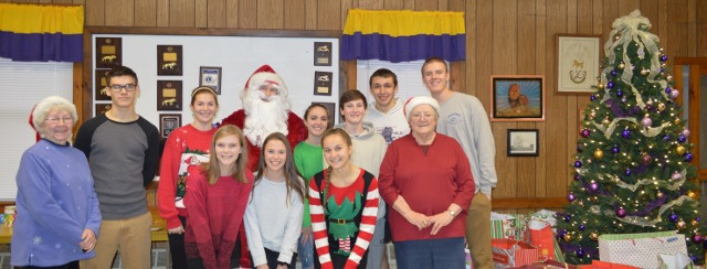 Whitefield Lions Club hosted its annual Christmas for Kids party Dec. 10. From left are Carolyn Greenwood, Caitlin Labbe, Dagan Savage, Lydia Gilman, Santa, Courtney Paine, Alana York, Olivia Kunesh, Alex Mahon, Harrison Mosher, Brenda Bonsant and Noah Bonsant.
