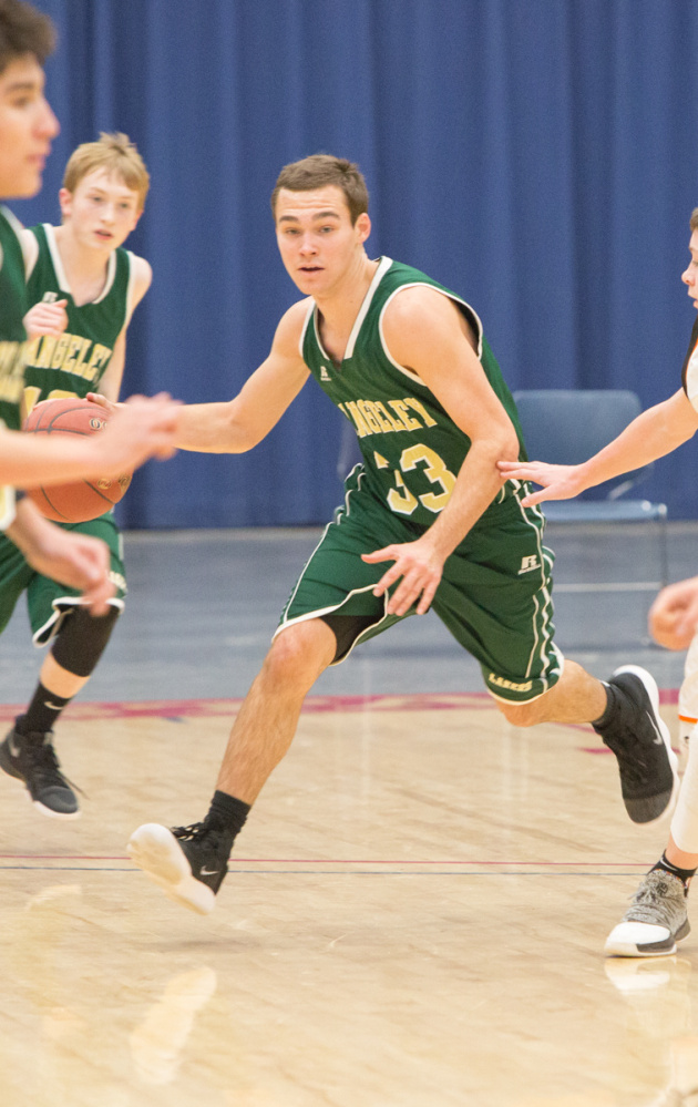 Rangeley's Kyle LaRochelle goes in for a basket against Forest Hills during the Capital City Hoop Classic on Friday at the Augusta Civic Center.
