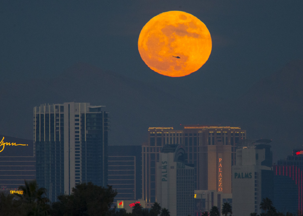 The first supermoon of 2018 rises above the Vegas Strip on Monday. A second full moon, or blue moon, arrives on Jan. 31.