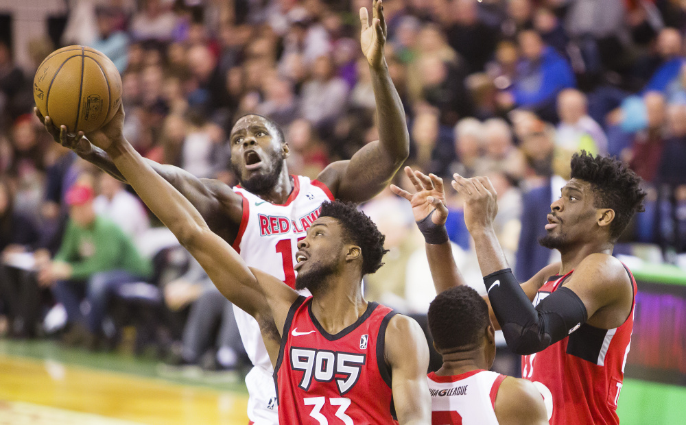 Anthony Bennett fights for a rebound with Kuran Iverson of Raptors 905 during the Red Claws' 100-93 loss Sunday afternoon at the Portland Expo. Bennett was playing his second game for the Red Claws after he was acquired in a trade in late December.