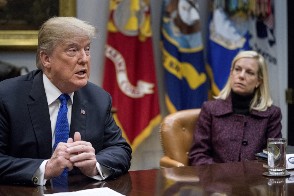 President Trump, accompanied by Secretary of Homeland Security Kirstjen Nielsen, right, meets with Republican senators on immigration in the Roosevelt Room at the White House in Washington. The Trump administration is ending protections for Salvadoran immigrants.