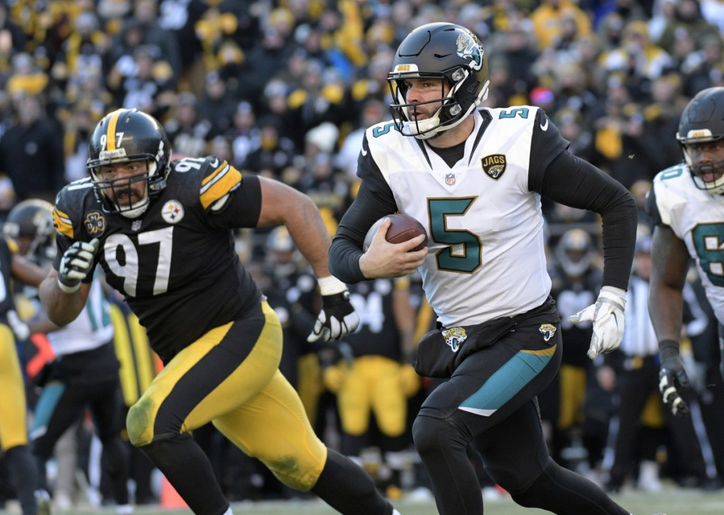 Jaguars quarterback Blake Bortles scrambles out of the pocket during Jacksonville's 45-42 win over the Pittsburgh Steelers in an AFC divisional round game Sunday in Pittsburgh. Jacksonville advance to the AFC championship game to face New England.