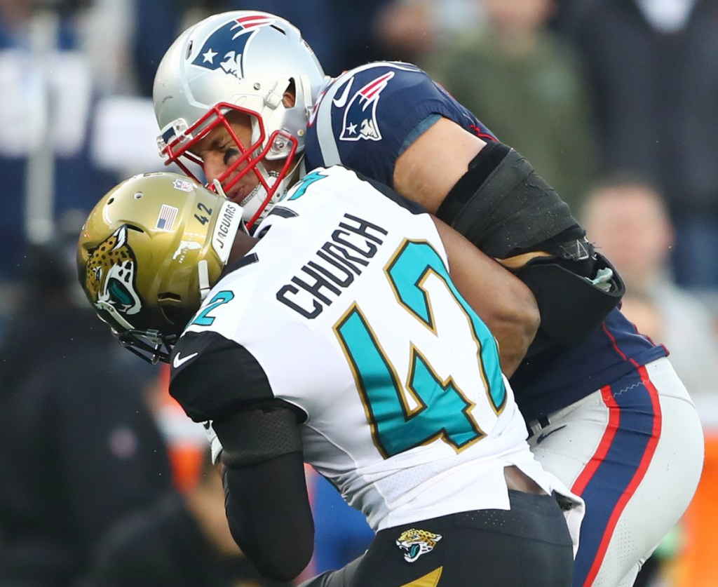Jacksonville strong safety Barry Church hits Patriots tight end Rob Gronkowski during the AFC championship game Sunday. Gronkowski left the game with a head injury.
