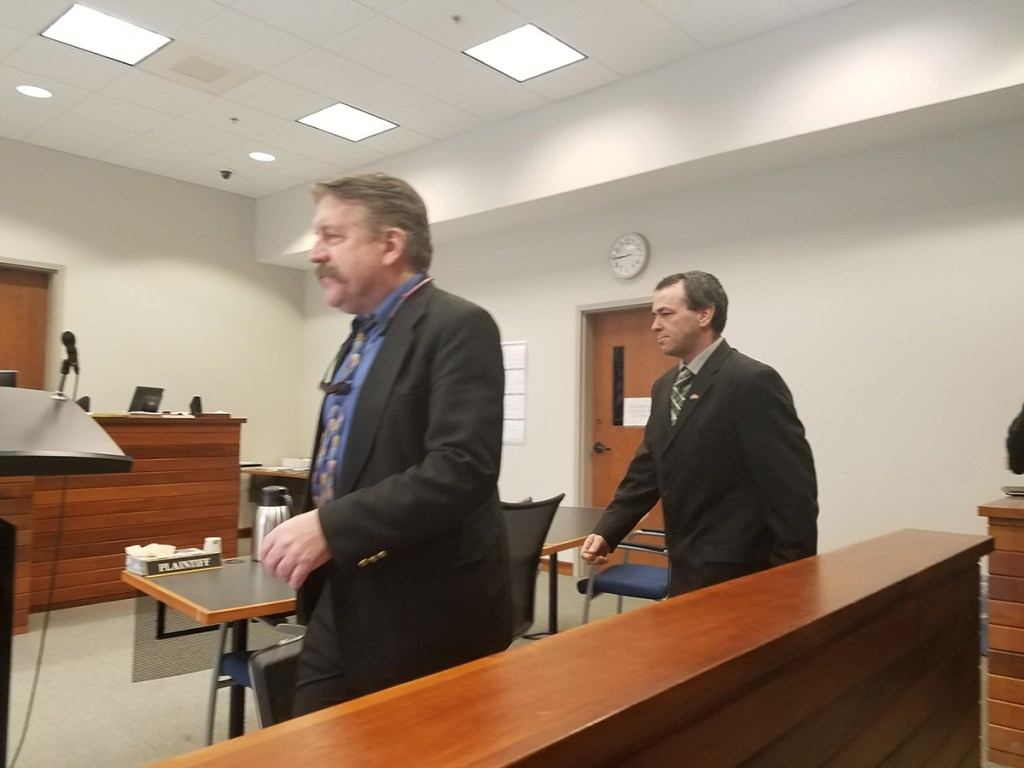 Former Lincoln County deputy Kenneth Hatch, right, enters the courtroom Friday with his attorney, Richard Elliot.
