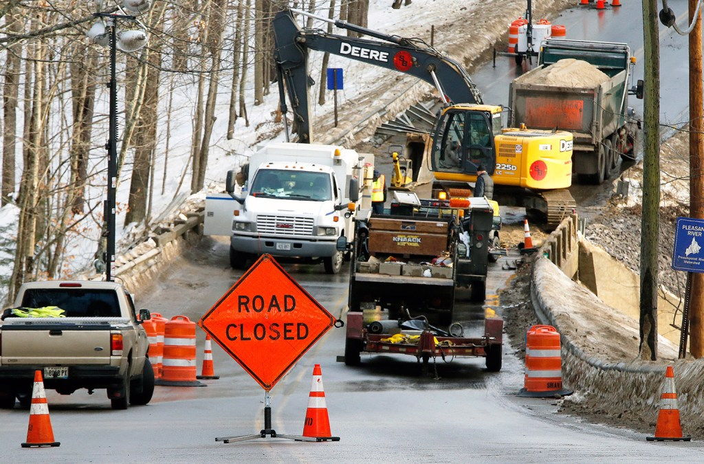 Windham Center Road was closed at the Pleasant River bridge Thursday while workers from Shaw Brothers Construction repaired a section of water main. The line broke in two places Wednesday morning. Thawing temperatures have caused water mains to break throughout the region.
