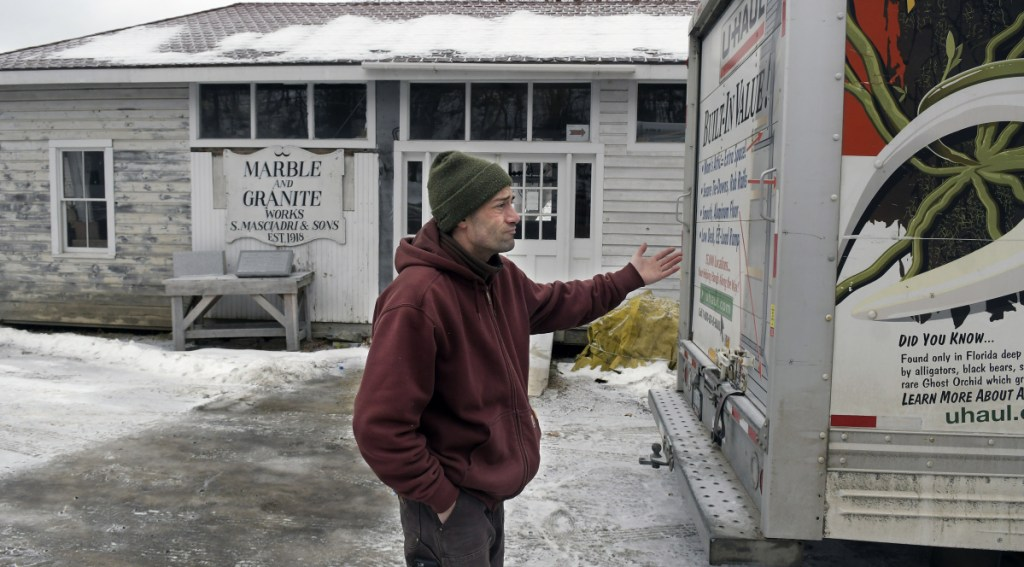 Nate Taczli said file cabinets and ephemera from the firm he manages, S. Masciadri & Sons, is loaded on a rental truck at the Hallowell headstone carver's shop on the banks of the Kennebec River in Hallowell. Forecasts call for rain and warmer temperatures on Tuesday, increasing the risks of flooding. The monument business has been located at the same spot since 1918.