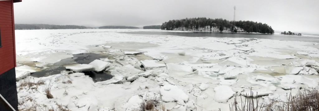 Ice chunks cling to the Kennebec River shore Tuesday at Chop Point School in Woolwich, where U.S. Coast Guard vessels are scheduled to arrive Wednesday as part of an early ice-breaking operation to ward off flooding in the Augusta area.