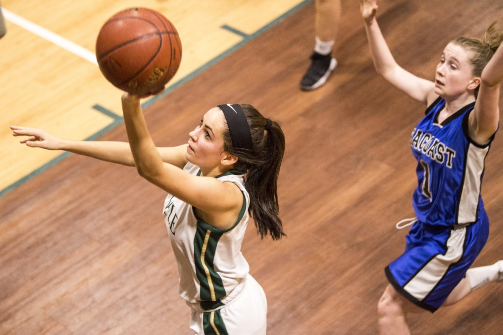 Temple Academy's Deleyni Carr, left, drives to the hoop as Seacoast Christian Academy's Meagan Vachon defends during a Jan. 12 game in Waterville.